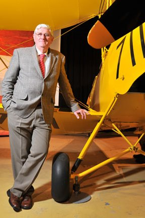 Portrait of David Gardner with a vintage aeroplane