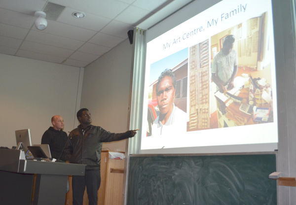 Yimunthu Max Gumana presents to CCMC staff and students about his job at the Buku-Larrnggay Mulka Art Centre