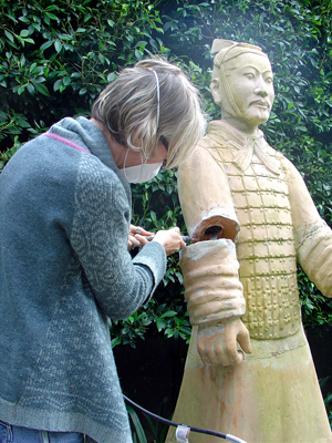 Treatment of a statue of an asian warrior