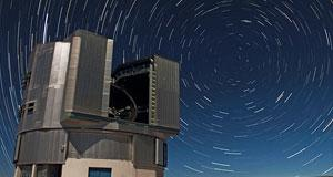 Unit Telescopes of ESO's Very Large Telescope (VLT) sitting beneath bright star trails' by Farid Char
