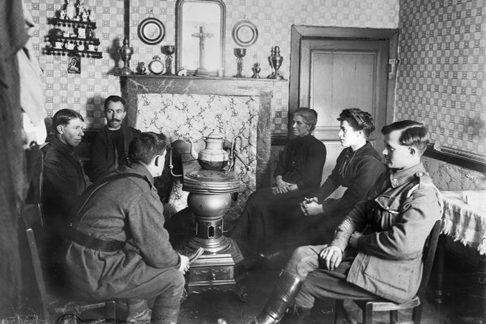 black and white photo of people in living room