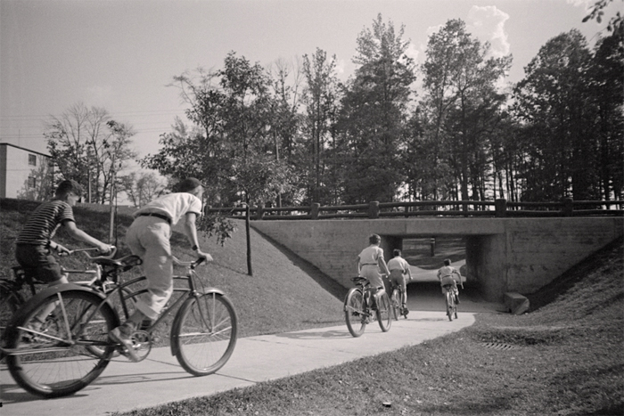 Children on bicycles and underpass