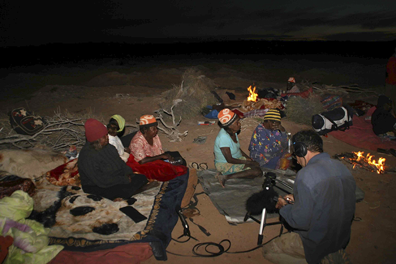 Dr Nick Thieberger recording a group of women singing in the Great Sandy Desert