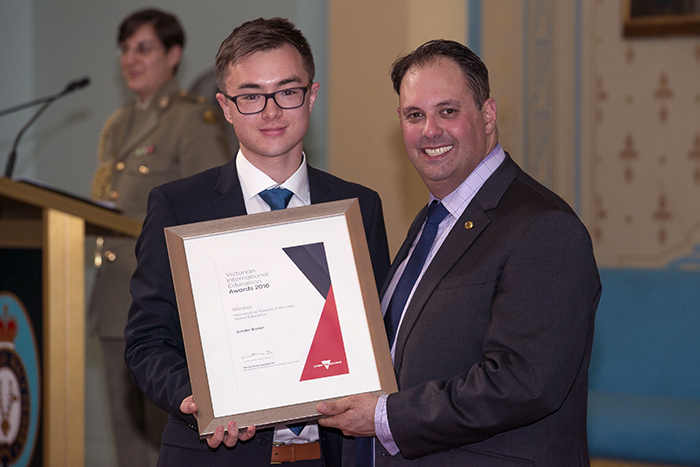 Sander Bredal being presented with his award by the Hon Philip Dalidakis,  Minister for Small Business, Innovation and Trade at Government House