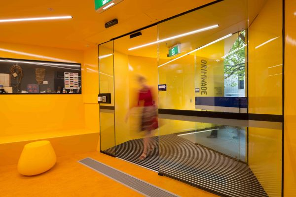 The bright orange and yellow foyer of the Grimwade Centre