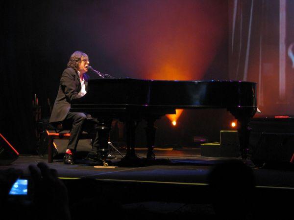 male musician at a piano
