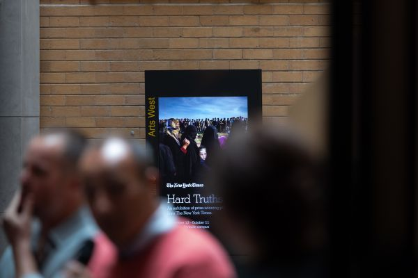 A digital screen advertising Hard Truths is displayed in Arts West