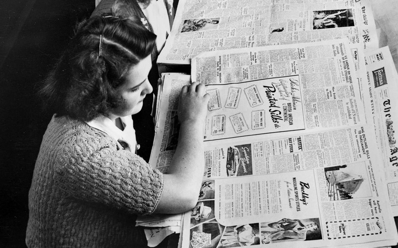 Unknown photographer. Newspaper section of Emily McPherson College Library, Russell Street, c. 1960s. The Biggest Family Album of Australia, Museums Victoria. Public domain
