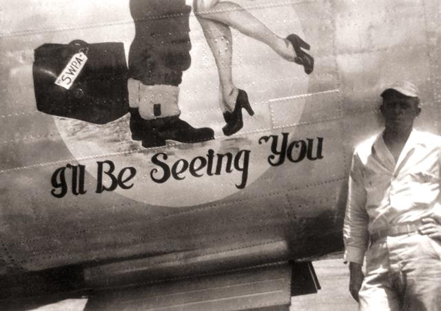 Photo of a man beside a World War 2 plane decorated with a couple embracing and the words I'll be seeing you