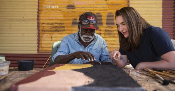 Portrait of Grimwade Centre Research Assistant Hannah Stewart with Warmun Art Centre worker Gordon Barney