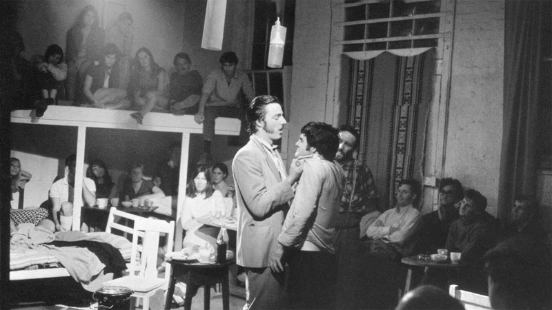 Two men on stage with audience watching