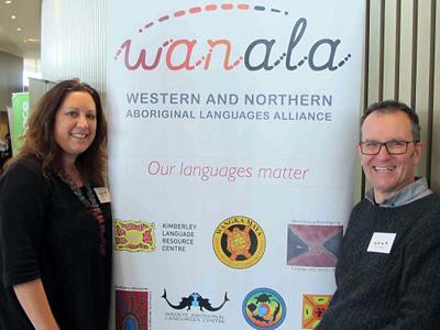 Rachel and Nick in front of WANALA sign