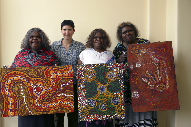 Makinti, Rebecca, Umatji and Katrina with the artworks