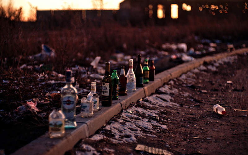 Alcohol bottles by the side of the road