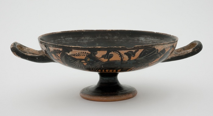 Attic black-figure kylix with Dionysiac procession on sides and satyr in tondo c. 500 BCE