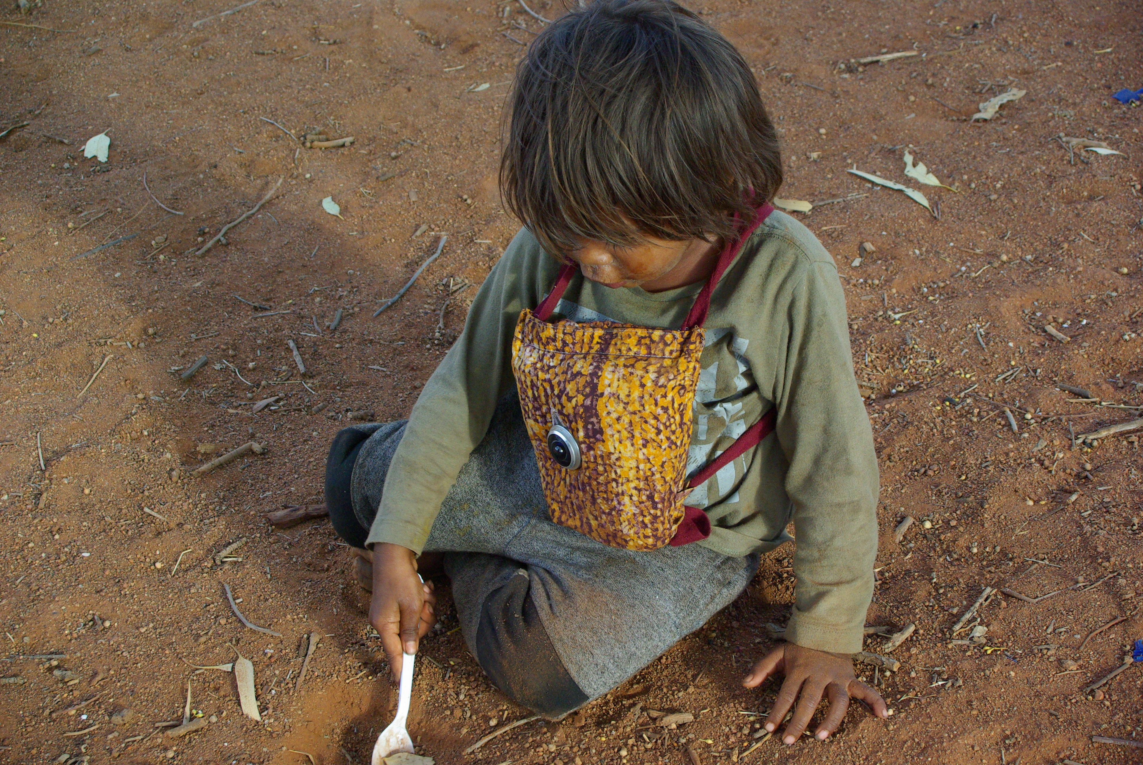 A child playing while wearing a recording device during fieldwork
